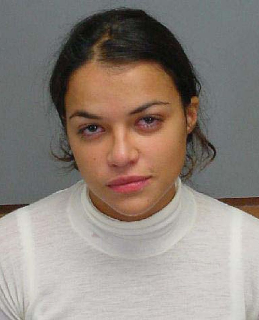 MICHELLE RODRIGUEZ - This photo provided by the Honolulu Police Department shows actress Michelle Rodriquez after her arrest for drunken driving in Kailua, Hawaii, in this Dec. 1, 2005 file photo.  Rodriguez was released from a Los Angeles County women's jail in Lynwood on Wednesday, Jan. 9, 2008, after serving 18 days of a 180-day sentence for violating probation in a drunken driving case, authorities said.  She was released early under a program that deals with jail overcrowding by allowing nonviolent female inmates to serve as little as 10 percent of their sentence. (AP Photo/Honolulu Police Department)
