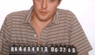 HUGH GRANT - This June 27, 1995 file photo shows a Los Angeles police booking photo of British actor Hugh Grant who was arrested  by Hollywood vice officers and charged with lewd conduct involving a prostitute. Interviews and surveys of officers at 200 police departments nationwide since 2008 found most consider targeting customers the best way to curb prostitution, because they fear publicity about the charges more than fines or even jail time.  The shaming techniques are particularly damaging because they publicly humiliate people prior to trial, for what remains a relatively minor offense, said Laurie Shanks, a professor at Albany Law School. Grant emerged little worse for the wear after being arrested.  (AP Photo/ho)