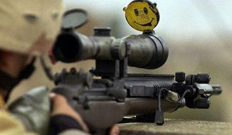 A happy face smiles back from the scope of a U.S. Army sniper's rifle, during a mission searching for insurgents in Mosul, Iraq, Nov. 22, 2004. (AP Photo/Jim MacMillan) ** FILE **