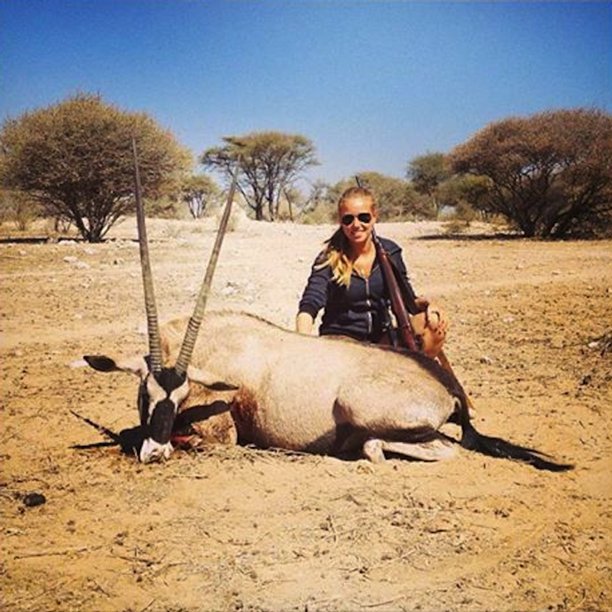 Axelle Despiegelaere, a Belgium teen who scored a contract with L'Oreal after being spotted in the crowd at a World Cup game, was criticized after a Twitter user posted this photo of her on a hunting trip in Africa.