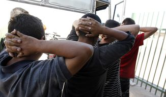 Newly arrived people who were caught in Arizona by the U.S. Border Patrol are initially processed at Tucson Sector U.S. Border Patrol headquarters in Tucson, Ariz., on Aug. 9, 2012. (Associated Press) **FILE**