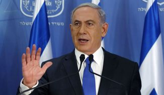 Israeli Prime Minister Benjamin Netanyahu gestures as he speaks during a press conference at the defense ministry in the Israeli coastal city of Tel Aviv on Friday, July 11, 2014. Netanyahu said he will not cave in to international pressure to stop a military offensive in the Gaza Strip. He told a news conference Friday that Israel will continue its offensive until rocket fire out of Gaza is halted. (AP photo/Gali Tibbon, Pool)