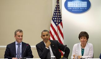 President Barack Obama, flanked by National Economic Council Director Jeff Zients, left, and senior White House Adviser Valerie Jarrett, meets with with company executives and their small business suppliers to talk about the economy, Friday, July 11, 2014, in the Eisenhower Executive Office Building on the White House in Washington. (AP Photo/Jacquelyn Martin)
