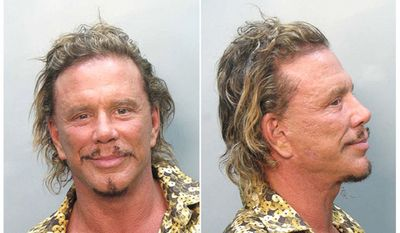 MICKEY ROURKE - the actor was arrested by Miami Beach police in November, 2007 and charged with driving under the influence. According to cops, Rourke was seen making an illegal U-turn on his Vespa scooter and then weaving across the road. Once stopped, police noted that Rourke had bloodshot eyes and smelled of booze. He also didn't perform well on a series of sobriety tests. Rourke, 55, was then transported to the Miami-Dade County jail where he posed for the above mug shot and was held on $1000 bond.