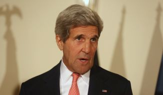 """U.S. Secretary of State John Kerry,  speaks, during a joint press conference in Kabul, Afghanistan, Saturday, July 12, 2014. U.S. Secretary of State John Kerry says both of Afghanistan's presidential candidates are committed to abiding by the results of the """"largest, most comprehensive audit"""" of the election runoff ballots possible. (AP Photo/Rahmat Gul)"""