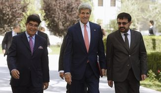 U.S. Secretary of State John Kerry, center, walks across the presidential palace grounds with Afghanistan's Foreign Ministry chief of protocol Ambassador Hamid Siddiq, left, and Foreign Minister Zarar Ahmad Osmani on his way to a meeting with Afghanistan's President Hamid Karzai in Kabul, Afghanistan, Saturday, July 12, 2014. Kerry visited Afghanistan in hopes of diffusing a crisis over the runoff presidential election to find a successor for outgoing President Karzai. (AP Photo/Jim Boug, Pool)