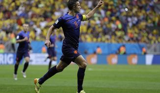 Netherlands' Robin van Persie celebrates after scoring his team's first goal on a penalty shot during the World Cup third-place soccer match between Brazil and the Netherlands at the Estadio Nacional in Brasilia, Brazil, Saturday, July 12, 2014. (AP Photo/Natacha Pisarenko)