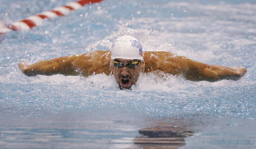 Michael Phelps competes in the men's 100-meter butterfly on his way to a first-place finish at the Bulldog Grand Slam swim meet at the University of Georgia, Friday, July 11, 2014, in Athens, Ga.  (AP Photo/David Goldman)