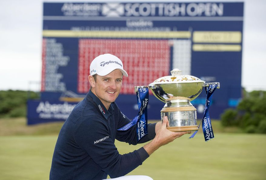 Justin Rose with the Scottish Open Trophy after winning the Scottish Open at Royal Aberdeen, Aberdeen, Scotland, Sunday July 13, 2014. (AP Photo/PA, Kenny Smith)  UNITED KINGDOM OUT  NO SALES  NO ARCHIVE
