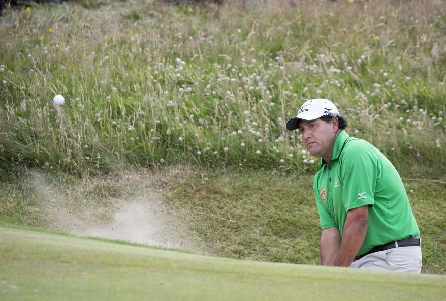 Argentinean Ricardo Gonzalez plays a shot from the greenside bunker on the 8th hole during day three of the Scottish Open at Royal Aberdeen, Aberdeen, Scotland, Saturday July 12, 2014. (AP Photo/PA, Kenny Smith) UNITED KINGDOM OUT  NO SALES  NO ARCHIVE
