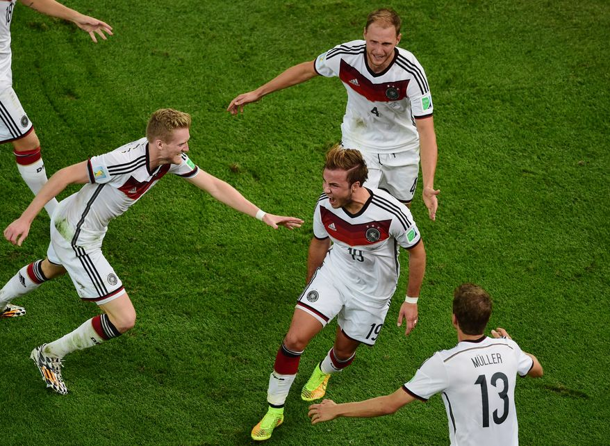 Germany's Mario Goetze, center, celebrates scoring his side's first goal during the World Cup final soccer match between Germany and Argentina at the Maracana Stadium in Rio de Janeiro, Brazil, Sunday, July 13, 2014. (AP Photo/Francois Xavier Marit, Pool)