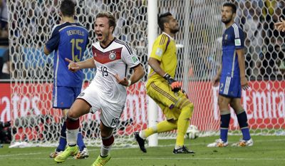 Germany's Mario Goetze celebrates after scoring the opening goal past Argentina's goalkeeper Sergio Romero during the World Cup final soccer match between Germany and Argentina at the Maracana Stadium in Rio de Janeiro, Brazil, Sunday, July 13, 2014. (AP Photo/Victor R. Caivano)