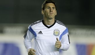 Argentina's Lionel Messi jogs during an official training session at Vasco da Gama Stadium a day before the World Cup soccer final between Germany and Argentina in Rio de Janeiro, Brazil, Saturday, July 12, 2014. (AP Photo/Victor R. Caivano)