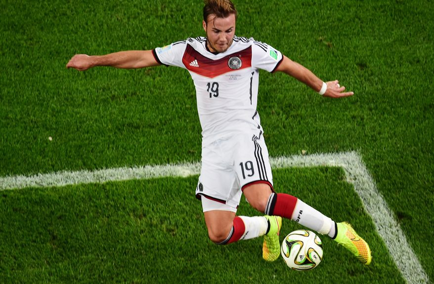 Germany's Mario Goetze scores his side's first goal during the World Cup final soccer match between Germany and Argentina at the Maracana Stadium in Rio de Janeiro, Brazil, Sunday, July 13, 2014. (AP Photo/Francois Xavier Marit, Pool)