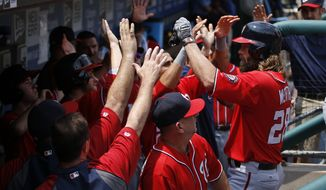 Washington Nationals' Jayson Werth, right, celebrates with his teammates after hitting a three-run home run off Philadelphia Phillies starting pitcher Kyle Kendrick during the first inning of a baseball game, Sunday, July 13, 2014, in Philadelphia. Washington won 10-3. (AP Photo/Matt Slocum)