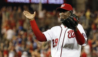 Washington Nationals relief pitcher Rafael Soriano celebrates after the last out of a baseball game against the Colorado Rockies at Nationals Park, Wednesday, July 2, 2014, in Washington. The Nationals won 4-3, and swept the three-game series with the Rockies. (AP Photo/Alex Brandon)