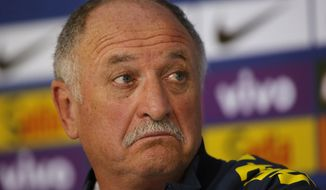 Brazil's coach Luiz Felipe Scolari gestures during a press conference at the Granja Comary training center in Teresopolis, Brazil, Wednesday, July 9, 2014. Brazilians woke up this morning to dreadful headlines describing their soccer team's historic defeat of 7-1 to Germany in the World Cup's semifinal. (AP Photo/Leo Correa)
