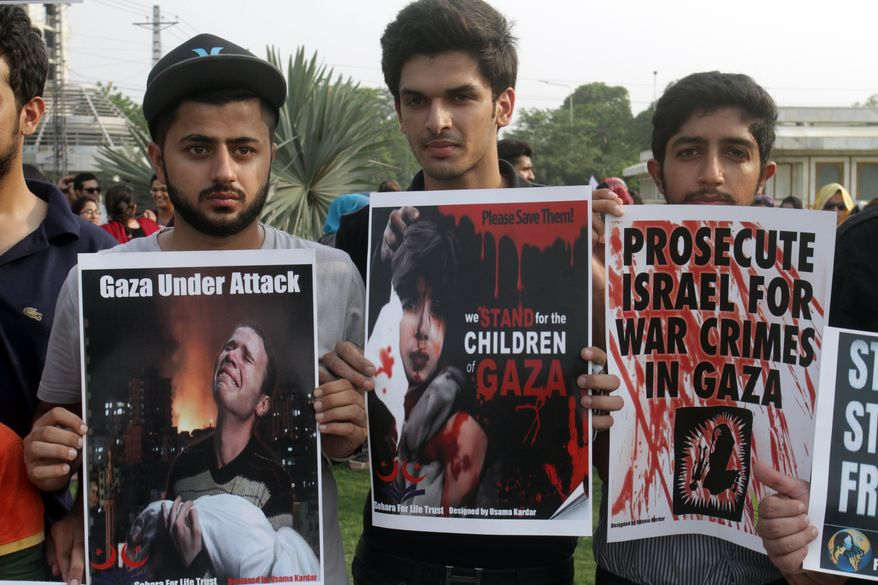 Pakistani students rally against the Israeli military operations in Gaza in Lahore, Pakistan. An online petition in the U.S. to cut off funds to Israel recently surpassed 100,000 signatures.  (AP Photo/K.M. Chaudary)