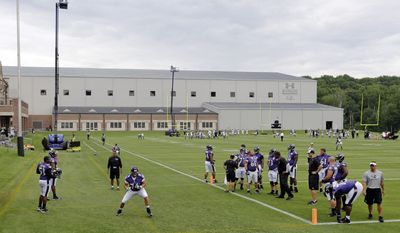 Baltimore Ravens tackle James Hurst, bottom left, performs a drill as teammates watch during NFL football minicamp, Thursday, June 19, 2014, at the team's practice facility in Owings Mills, Md. (AP Photo/Patrick Semansky)