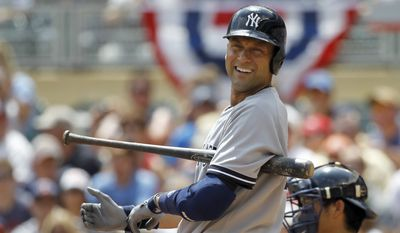 New York Yankees'  Derek Jeter looks to third base coach Rob Thomson during the first inning of a baseball game against the Minnesota Twins in Minneapolis, Sunday, July 6, 2014. (AP Photo/Ann Heisenfelt)