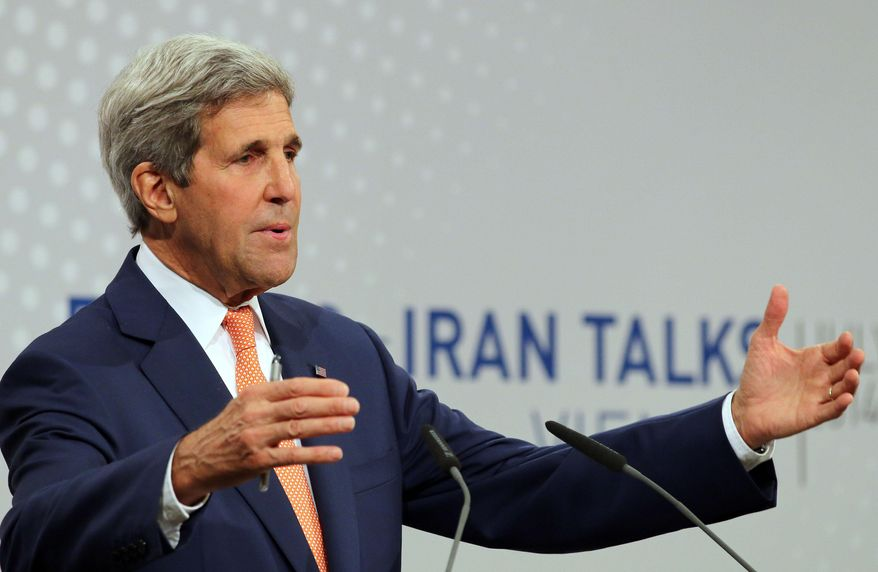 U.S. Secretary of State John Kerry speaking to the media after closed-door nuclear talks on Iran take place in Vienna, Austria, Tuesday, July 15, 2014. (AP Photo/Ronald Zak)