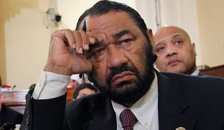 Rep. Al Green said on the House floor Wednesday morning that he plans to fly five American flags on Capitol Hill to honor the St. Louis Rams players who entered the field on Sunday in a 'hands-up, don't shoot' pose expressing solidarity with Ferguson protesters. (Associated Press) ** FILE **