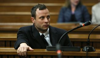 FILE - In this Tuesday, July 8, 2014 file photo Oscar Pistorius sits in the dock in Pretoria, South Africa, at his murder trial for the shooting death of his girlfriend Reeva Steenkamp on St. Valentine's Day, 2013. In newspaper reports Pistorius has been accused of an aggressive altercation at a Johannesburg nightclub he visited at the weekend.  A spokeswoman for the Pistorius family said an argument ensued and the athlete, who is free on bail, soon left the club. He had been seated in a quiet booth in the VIP section, she said in a statement. (AP Photo/Alon Skuy, Pool, File)