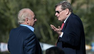 **FILE** Major League Baseball commissioner Bud Selig, right, talks with Baltimore Orioles owner Peter Angelos, left, after the MLB owners meeting in Paradise Valley, Ariz., Thursday Jan. 15, 2009. (AP Photo/Aaron J. Latham