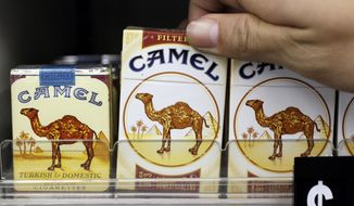 Camel cigarettes, a Reynolds American product, are on display at a liquor store in Palo Alto, Calif., on Feb. 1, 2011. (Associated Press) **FILE**