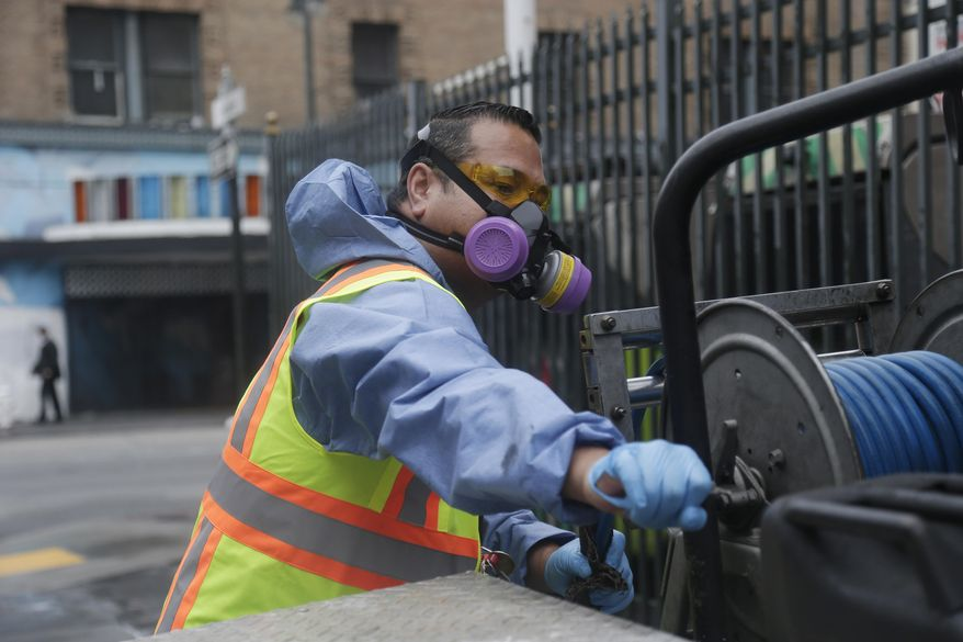 Eighi Hiastake, of the San Francisco Dept. of Public Works, retracts a hose onto his truck after washing a city sidewalk with a mixture of water and disinfectant on Tuesday, July 15, 2014, in San Francisco. In one of the most drastic responses yet to California's drought, state regulators on Tuesday will consider fines of up to $500 a day for people who waste water on landscaping, fountains, washing vehicles and other outdoor uses. The rules would prohibit watering of landscaping to the point that runoff spills onto sidewalks or streets. Hosing down sidewalks, driveways and other hard surfaces would be prohibited, as would washing vehicles without a shut-off nozzle. (AP Photo/Marcio Jose Sanchez)