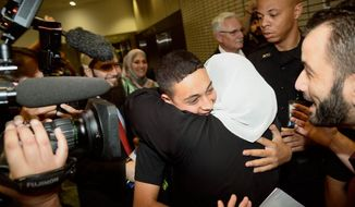 Tariq Khdeir, the Palestinian-American teen who relatives allege was beaten by Israeli authorities, is greeted by family after he arrived at Tampa International Airport Wednesday night, July 16, 2014.  Tariq Abu Khdeir told supporters that their prayers had gotten him through his ordeal.  (AP Photo/The Tampa Tribune, Jason Behnken)