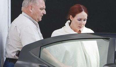**FILE** Shannon Richardson is placed into a Titus County Sheriff's car after an initial appearance at the federal building Texarkana, Texas, on June 7, 2013. A federal grand jury has indicted an Richardson, who authorities say sent ricin-laced letters to President Obama and others in an attempt to frame her estranged husband. (Associated Press/The Texarkana Gazette)