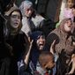 In Gaza City, Palestinian relatives grieve for four boys from the same extended Bakr family. The cousins, ages 9 to 11, were killed while playing on a beach. (Associated Press photographs)