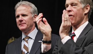 The Israeli ambassador to the United States Michael B. Oren, left, is applauded by John Andrews, director of the Centennial Institute at Colorado Christian University, after Oren spoke at a lunch at the school in Lakewood, Colo., on Tuesday, Mar. 1, 2011. The ambassador said his country would like to be guardedly optimistic about the string of uprisings in the Middle East. Oren received a friendly welcome from the crowd of about 200 at the campus. (AP Photo/Ed Andrieski)