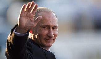 ** FILE ** Russia's President Vladimir Putin waves to photographers as he leaves the Itamaraty Palace after attending the final day of the BRICS Summit in Brasilia, Brazil, Wednesday, July 16, 2014. (AP Photo/Felipe Dana)