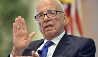 News Corp. CEO Rupert Murdoch speaks during a forum on The Economics and Politics of Immigration in Boston in this Aug. 14, 2012, file photo.  (AP Photo/Josh Reynolds, File)