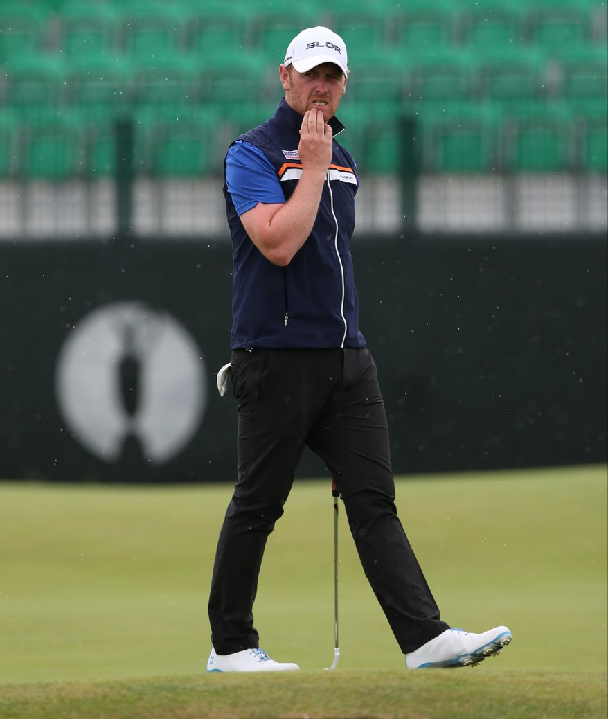 John Singleton of England looks at his ball on the 3rd green during a practice round ahead of the British Open Golf championship at the Royal Liverpool golf club, Hoylake, England, Wednesday July 16, 2014. The British Open Golf championship starts Thursday July 17. (AP Photo/Jon Super)