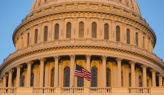 FILE - In this Sept. 16, 2013, file photo, the U.S. Capitol at sunset in Washington. Democrats and Republicans are fervently pursuing a batch of doomed bills in Congress because they target a coveted prize in the Nov. 4 elections: female voters. Wednesday, July 16's Senate vote on contraception legislation is the latest example of Democrats' win-by-losing strategy, which forces Republicans to vote on sensitive matters that might rile women this fall.  (AP Photo/J. Scott Applewhite, File)