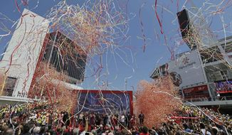 Confetti rains down during the ribbon-cutting and opening of Levi's Stadium Thursday, July 17, 2014, in Santa Clara, Calif. The San Francisco 49ers held a ribbon-cutting ceremony to officially open their new home. The $1.2 billion Levi's Stadium, which took only about 27 months to build, also will host the NFL Super Bowl in 2016 and other major events. (AP Photo/Eric Risberg)