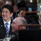 Japan's Prime Minister Shinzo Abe (left) and Australia's Prime Minister Tony Abbott watch traditional Japanese drum performance at Parliament House in Canberra, Australia. Mr. Abe's warm reception in Australia has angered China. (Associated Press)