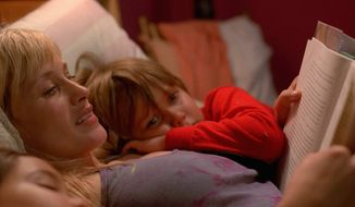 """Patricia Arquette and Ellar Coltrane star in """"Boyhood,"""" produced through an innovative technique that follows the characters — and actors — over the course of 12 years. (IFC Films Via Associated Press)"""