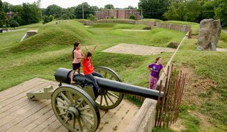 Angie Gonzales (left), 7, her sister Ashley (center), 8, and their cousin Jocelyn Granados, 11, turn a Civil War battle site into a playground at Fort Stevens in D.C. (Andrew Harnik/The Washington Times)