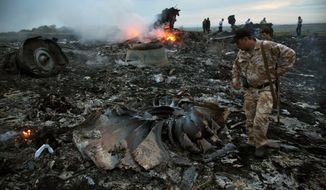 The debris field at the crash site was grisly and widespread. Pro-Russia separatists declared a three-day cease-fire for recovery efforts and investigation of the passenger plane downing that killed all 298 people aboard on Thursday. (Associated Press)