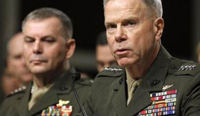 ** FILE ** Marine Corps Commandant Gen. James Amos, right, accompanied by Joint Chiefs Vice Chairman Marine Corps Gen. James Cartwright, testifies on Capitol Hill in Washington on Dec. 3, 2010. (Associated Press)