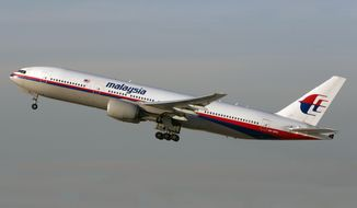 In this Nov. 15, 2012 photo, the Malaysia Airlines Boeing 777-200 with tail number 9M-MRD _ the same aircraft that was shot down near the Ukraine Russia border on Thursday, July 17, 2014 _ takes off from Los Angeles International Airport. Ukraine said the passenger plane was shot down Thursday as it flew over the country, and both the government and the pro-Russia separatists fighting in the region denied any responsibility for downing the plane. (AP Photo/JoePriesAviation.net)