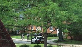 Police are shown outside Gamertsfelder Hall on the Ohio University campus on Tuesday, July 15, 2014, in Athens, Ohio in this file photo taken via smartphone. On Oct. 3, 2019, the university announced that all 15 of the registered fraternities on campus were under suspension amid an investigation into incidents of hazing. (AP Photo/Matt McKnight) MANDATORY CREDIT **FILE**