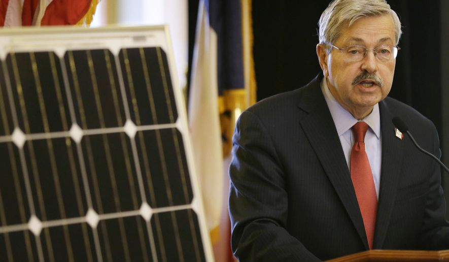 FILE - In this April 9, 2014 file photo Iowa Gov. Terry Branstad speaks during the Iowa Solar and Small Wind Energy Trade Association Day at the Statehouse in Des Moines, Iowa. Branstad's administration surrendered a $1 million grant designed to make Iowa a nationwide leader in solar energy after electric utilities lobbied for major changes, emails show. (AP Photo/Charlie Neibergall, File)
