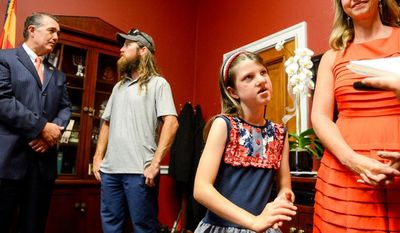Rep. Trent Franks (R-Ariz.), left, invites Mia Robertson, 10, second from right, the daughter of Jase, second from left, and Missy Robertson, right, of the television show Duck Dynasty to visit with him in his Capitol Hill office,  Washington, D.C., Tuesday, July 8, 2014. Both Rep. Franks and Mia have had a cleft palate surgery and the family has started the Mia Moo Fund, a non-profit organization that is dedicated to raising awareness and funds towards research, treatments and causes of cleft lip & palate. (Andrew Harnik/The Washington Times)