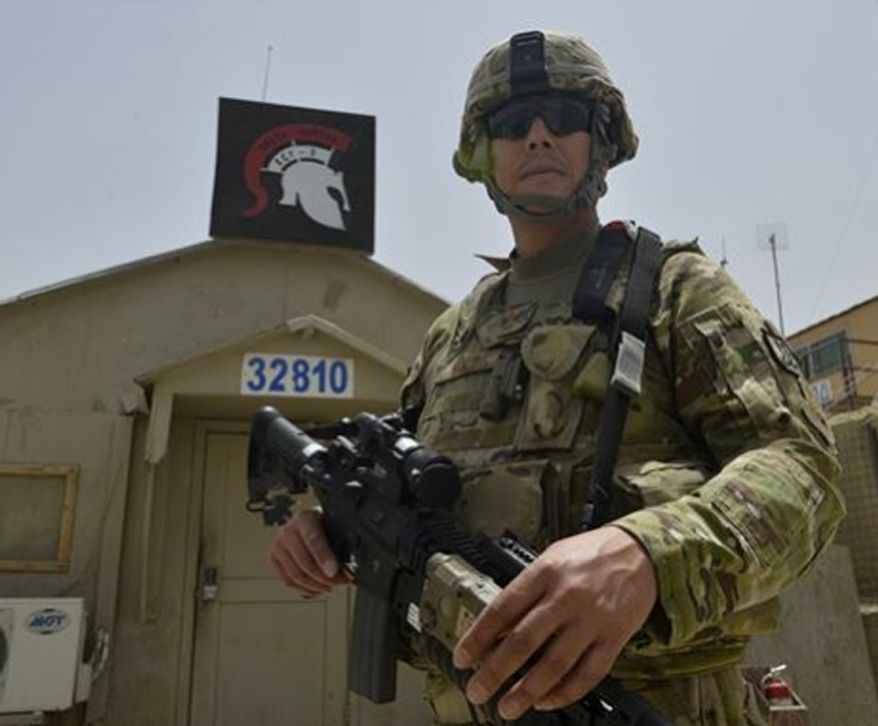 ** FILE ** Staff Sgt. Jesus Yanez stands in front of his sector station July 2, 2014, on Bagram Airfield, Afghanistan. Yanez has served in four military branches throughout his career. He is a 455th Expeditionary Base Defense Squadron defender and a native of El Paso, Texas. (U.S. Air Force photo/Staff Sgt. Evelyn Chavez)