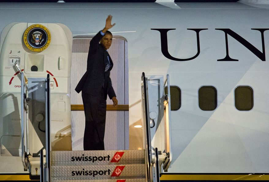 ** FILE ** President Barack Obama boards Air Force One at John F. Kennedy International Airport in New York, Thursday, July 17, 2014. Earlier he attended fundraising events in New York City. (AP Photo/Craig Ruttle)
